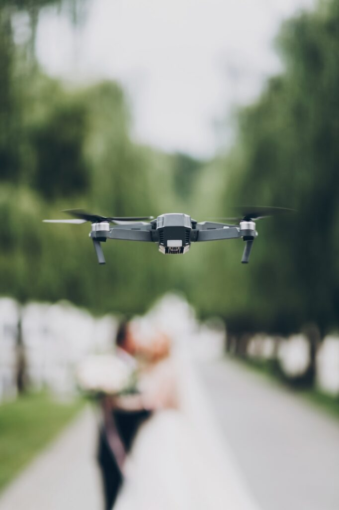 Drone flying in green park